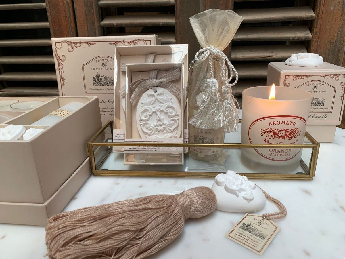 orange blossom single candle in gift box