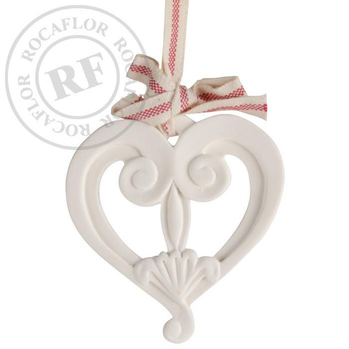 orange cinnamon heart half open on ribbon